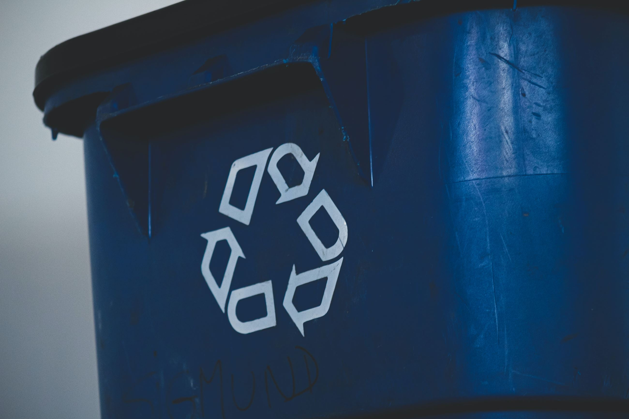 Recycling Symbol on the side of a trash can